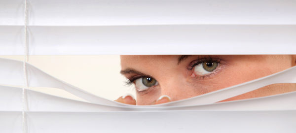 Woman peering through blinds © auremar - Fotolia.com #45534695